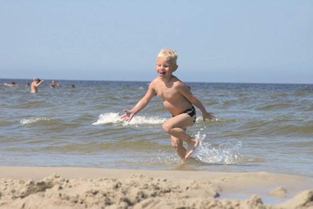 On the beach. Folk tour – Hit The Road Travel